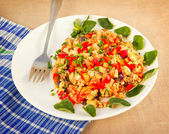 Scrambled eggs with tomato, ham, bell pepper — Stock Photo