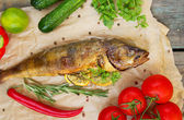 Fried fish with fresh herbs and lemon — Stock Photo