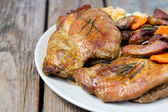 Baked meat on a wooden table — Stock Photo