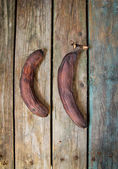 Overripe, rotten and black banana on wooden table — Stock Photo