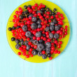 Mixed berries in the green plate — Stock Photo #51411725