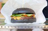 Delicious black hamburger — Stock Photo