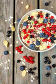 Muesli with fresh berries on wooden background. — Stock Photo