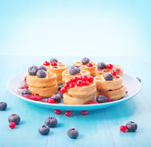 Round waffle with berries — Stock Photo