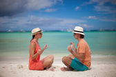 Young couple enjoying each other and yoga on a beach — Stock Photo
