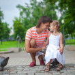 Stock Photo: Young happy father with daughter in park have fun