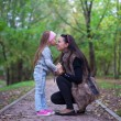 Cute little girl kissing her mother's nose — 图库照片