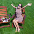 Young beautiful woman resting and has fun in the yard — Stock Photo