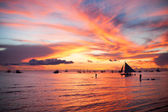 Sailing boat to the sunset in Boracay island on Philippines — Stock Photo