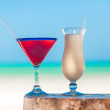 White pina colada and red margarita on the beach table — Stock Photo