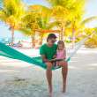 Father with little daughter on tropical vacation relaxing in hammock — Stock Photo
