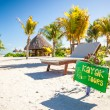 Stock Photo: Exotic hotel at tropical resort on sea shore with a bright sign