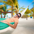 Young man in hammock on the exotic tropical resort — Stock Photo