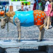 Foto de Stock  : Multicolored figure of donkey into port on Santorini island