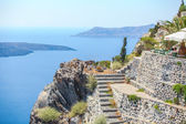 Traditional sights of colorful ladder and caldera sea in background — Stockfoto