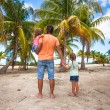 Rear view of father with two kids walking at beach — Stock Photo