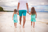 Rear view of father and his two kids walking by the sea — Stock Photo