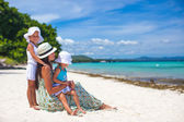 Young mother and two her kids at exotic beach on sunny day — Stock Photo