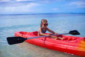 Little adorable girl kayaking in the clear sea — Stock Photo