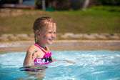 Profile of a little girl enjoy in the swimming pool — Stock Photo