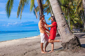 Romantic couple at tropical beach near palm tree in Philippines — Stock Photo