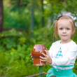 Portrat of little girl standing near vintage wooden rural fence — Stock Photo