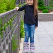Little cute girl on roller skates in front of her home — Stock Photo