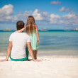 Rear view of young father and his little daughter look at the sea — Stock Photo #28952901