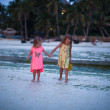 Little adorable girls in exotic resort in nice dress in the evening — Stock Photo