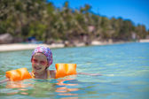 Little happy girl with diving in the sea and smiling — Stock Photo
