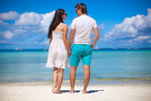 Romantic couple at tropical beach in Philippines look at the sea — Stock Photo