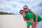 Young couple having fun on a tropical beach — Stock Photo