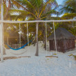 Simple wooden swing in a nice hotel on an exotic beach — Stock Photo #29290201