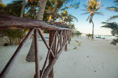 Beach wooden fence on tropical white beach — Stock Photo