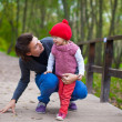 Portrait of Young father walking with his cute daughter in autumn park — Stock Photo