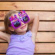 Adorable little girl in Happy Birthday glasses have fun outdoor — Stock fotografie