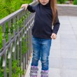 Little cute girl on roller skates in front of her house — Stock Photo #29807251