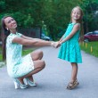 Happy young mother and her daughter having fun outdoors — Stockfoto