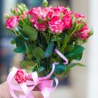 Charming bouquet of roses in woman's hand — Stock Photo