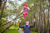 Young father with his cute little daughter have fun outdoor — Stock Photo