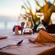 Close-up empty wine glass on the set table at sunset — Stock Photo