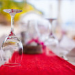 Close-up of wine glass on the set table for banquet at sunset — Stock Photo