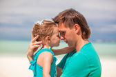 Portrait of a little girl and her young dad embracing — Stock Photo