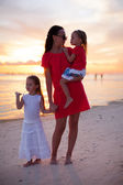 Mom and daughters silhouette in the sunset at the beach on Boracay — Stock Photo