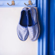 Blue women's slippers in Greek style of house on the Cycladic Islands — Stock Photo
