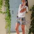 Young stylish woman talking on phone in the Greek village of Emporio near her old home — Stock Photo
