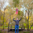 Young father with his cute little daughter have fun outdoor in the park — Stock Photo