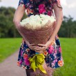 Incredibly beautiful large bouquet of white roses at the hands of a young girl in colored dress — Stock Photo