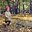 Little beautiful girl walking in autumn park — Stock Photo