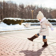 Little cute girl walks in the winter on a sunny day outdoors — Foto Stock